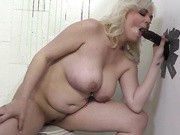 Fat blond enjoys fucking random guys at glory hole