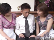 One lucky young guy and two lovely Japanese milfs fool around