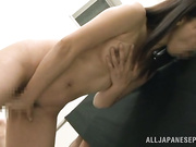 Dirty Asian gets on knees and sucks cock through gloryhole