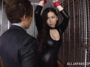 Skintight black leather is breathtaking on the Asian babe in bondage