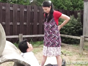 Appealing Asian diva Emiko teases and gets her pussy pounded