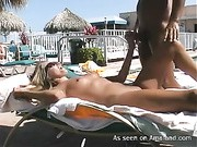Petite brunette bounces on large cock and gives hot blow job by pool