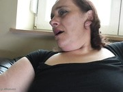 Sizzling hot lesbian cuties make out and fuck on a couch