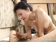 Horny and hot mature Japanese AV Model is getting her tits pokes and a fingering by her horny younger guy