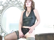 Milf strips out of tight leather, rubs her smooth naked pussy and dildos herself to orgasm in stockings and heels