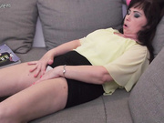 Naughty European mature lady playing with her wet pussy