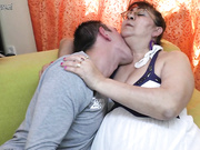 Mature slut sucking a hard cock