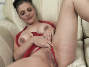 Horny brunette housewife getting herself wet