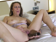 Housewife Norma loves to play on her bed